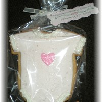 Onesie Cookie..   NFSC with fondant and royal accents..