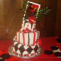 Red, White, And Black Whimsical  This was my first whimsical cake. It was for my nephew's graduation party..he wanted an Asian theme, so his picture is held up with...