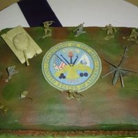Army Groom's Cake   Military Groom's cake. Chocolate cake with choc BC frosting painted with colormist, seal is edible image, toy soldiers.