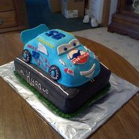 Dinoco Mcqueen  I made this cake for a friend of mine whos son wanted the blue McQueen, hes on top of a two layer 9X13 and used the cruiser pan for the car...