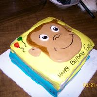 Curious George I made this cake for a friend of mine who grew up with Curious George Books. 11 x 15 cut and stacked, covered in MMF