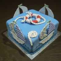 Boating Cake White Mud cake, white chocolate ganache and fondant icing.