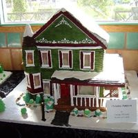 Victorian Gingerbread House  This was for a contest. I took 3rd place. The windows are made of hard candy so they were slightly see through and the house and lamp post...