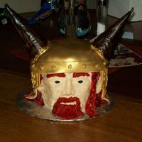 Viking Head I made this for my friend's birthday. The face and hair is buttercream. The helmet is fondant.