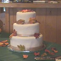 Fall Wedding This is a pumpkin spice cake with spiced bc covered in fondant. The leafs are gumpaste colored with food coloring.