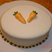 Cakes_009.jpg This was a very simple cake. I had never covered a cake with fondant before. So i gave it a try. Its a carrot cake with cream chesse icing...