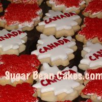 Canada Cookies Wow...we made a TON of these. They are to give out at our local Canada Day parade! Maple leafs with sugar crystals, and fondant