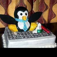 Scientist Penguin This was made for a groom's cake. He is a science teacher that loves penguins :) They are hard to see but he is sitting on part of the...