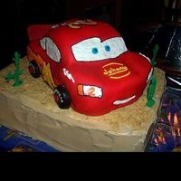 3D Lightning Mcqueen Cake I made this for my son's 2nd birthday. The car is covered in fondant I piped the details with butter cream. My instructions on how to...
