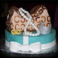 Coach Bag And Tiffany Box Cake W/jewelry The round Tiffany box and Coach bag are cake while the jewelry and bow are gumpaste. You can see how I made this cake by copying and...