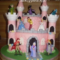 Princess Castle for my 5 yr old DD. MMF embossed w/ stone mat; used the wilton castle pillars. Disney store figures... the dragon was the favorite figure...