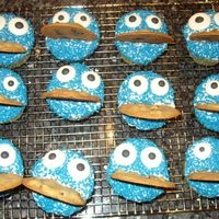 Cookie Monster Cupcakes  I got this idea from cupcake pictures from the internet. I made vanilla chocolate chip cupcakes and used vanilla buttercream with blue...