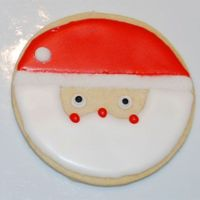 Santa Cookie  I got this cookie design from the book Cookie Craft by Valerie Peterson & Janice Fryer. I also sprinkled white sugar on the brim of the...