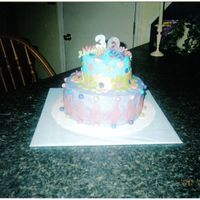 30Th Birthday This was a golden butter cake with peanut butter buttercream filling. The icing is buttercream with rolled buttercream and fondant accents...