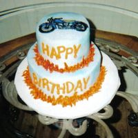 Motorcycle Cake Motorcycle is BCT. The cake is iced with buttercream, airbrushed and piped flames.