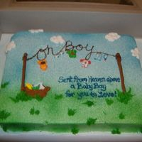 Boy Clothes Line Cake airbrushed buttercream icing, fondant clothes, and buttercream piping.