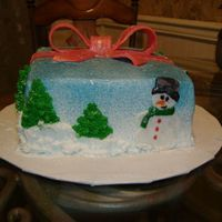 Christmas Present MMF bow, buttercream Icing and piping, rolled buttercream snowman