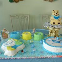 Baby Shower Bear   This is a creation using various cake pans, winnie the pooh, 12 x 3, 6 x 3 and