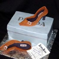 Prada Shoes Shoes are hand-molded with sugarpaste. The box is a buttercream iced cake.