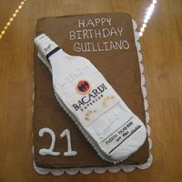 Bacardi Bottle Cake Everything but the labels & bottle cap are done in buttercream. Labels are fondant with edible marker.
