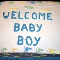 Baby Feet  Yellow Cake filled with 1/2 Strawberry & 1/2 Pineapple. The invatations were printed on paper with baby feet as the border, so I used...