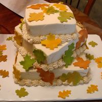 My First Wedding Cake   I was a little nervous, but I like the way it came out. The bride loved it. The leaves are made from chocolate clay.