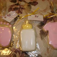 Baby Shower Cookies  Almond Sugar Cookies with antonia74's royal icing. I had a little trouble getting the right consistency. I need to work with it a...