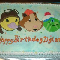 Wonder Pets Sheet/flyboat Smash This is a half sheet, all vanilla cake w/ Wonder pets faces made from fondant. The Flyboat smash cake is a cut 6 in. round covered in mmf...