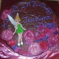 Tinkerbell In The Woods This is a vanilla cake w/ Hershey's recipe chocolate frosting. TInk's wings are rice paper dusted w/ pearldust and the roses are...