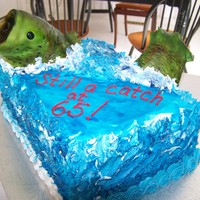 Rich's Fish   Chocolate and vanilla cake, with chocolate ganache filling. Fish was made of RKT and covered in fondant.