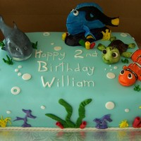 William's Nemo   Nemo cake made for a boy turning 2! Yellow cake with Vanilla Mousse. Gumpaste characters, fondant decorations.