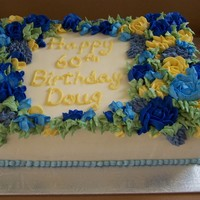 Doug's Birthday Alternating layers of yellow cake and chocolate cake with vanilla mousse.