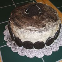 Cookies And Cream Chocolate cake with cookies and cream filling covered in cream cheese icing and oreos