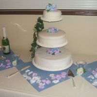 3 Tier chocolate cake with bavarian cream, vanilla cake with strawberry and choccolate cake with strawberry all covered in fondant with roses,...