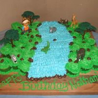 "Diego Cupcake Cake Thanks to CranberryClo for the idea! This was a HUGE hit at my sons' 4th birthday party!!! I used 58 cupcakes for this, ""Diego&..."