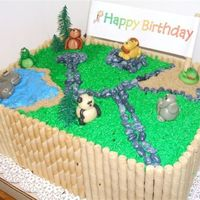 Zoo Birthday Cake Chocolate cake with chocolate mousse filling, animals are marzipan, fence is pirouette cookies
