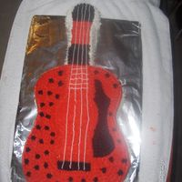 My 6Th Character Cake Ever Nothing fancy, simple boxed cake mix, store bought icing, & my own version of the Guitar since I didnt have a picture to go off of.
