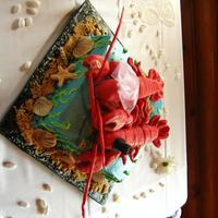 Lobster Couple Groom's Cake Modeling chocolate lobsters, fondant seashells, red velvet cake and buttercream frosting with raspberry filling, brown sugar sand. My first...