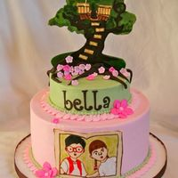 "Magic Tree House Tree House is made from gumpaste with fondant and handpainted. 6"" single layer on top of 9""."