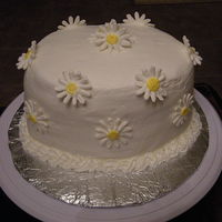 Daisy Cake I did this cake as a favor for a friend with a days notice. So I know it is not perfect but I did it anyhow. It is a white cake with butter...