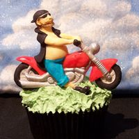 Dude On A Bike Cupcake! This was a Fathers Day cupcake I made for a competition on Flickr in the group Flickr Bake- Off!