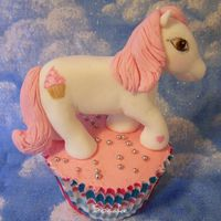 My Little Pony Cupcake   Hand made Fondant My Little Pony on a cupcake. I made this for a challenge in the Flickr group Sweet Treats!