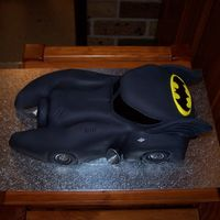 The Batmobile I made this for my sons 5th birthday.10inch round chocolate mudcake cut and carved to look like the batmobile then covered in black fondant...