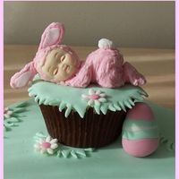 Easter Baby Cupcake A little fondant baby in a royal icing bunny suit sleeping on a cupcake!Happy Easter!!