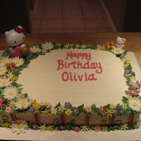 Hello Kitty   Chocolate cake iced in buttercream, all flowers are MMF. Customer provided me with the Hello Kitty figures.