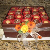 Cake Made To Look Like A Box Of Choclates.  8 inch peanut butter cake. Sides of box are dark chocolate. Truffles are homemade buckeyes and chocolate/peanut butter truffles. Flowers...