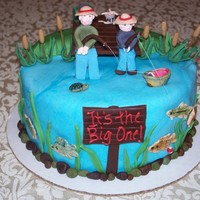 Fishing Birthday Cake   Cake I made for my Father In Laws 50th. It is supposed to be him fishing with my son, something they love to do.