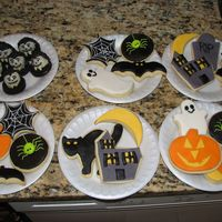 Halloween Cookies   sugar cookies coverered in MMF. The draculas are truffles dipped in white chocolate.