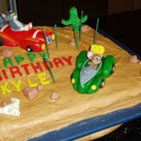 Tom & Jerry This is my sons 6th Bday cake. He was very specific about what he wanted Tom and Jerry in race cars in the desert and all the dils on the...