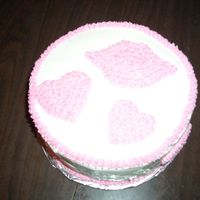 Hearts And Kisses   First cake using the cookie cutters and star tip. Boy I need a lot of practice!